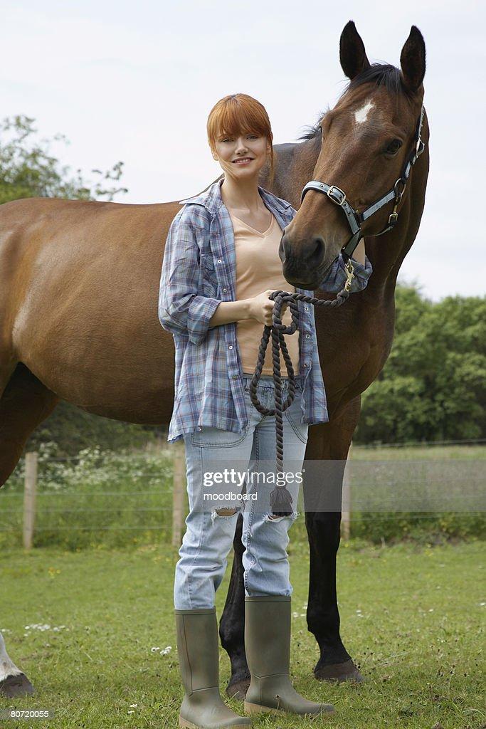 Woman Petting Horse : Stock Photo