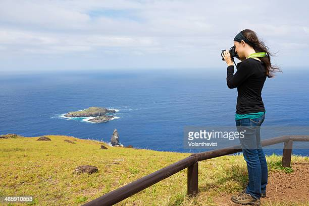 Woman photographer by the sea in Easter Island