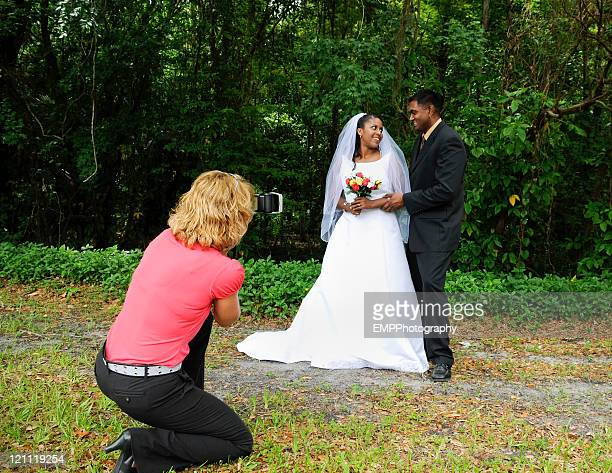 Woman Photographer Photographing Diverse Wedding Couple