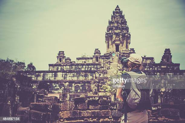 Woman Photographer Taking Picture at Bakong Temple, Cambodia