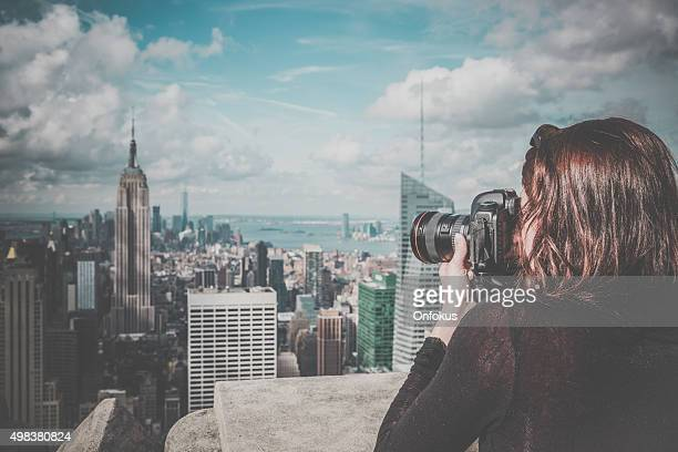 woman photographer taking picture of the Empire State Building