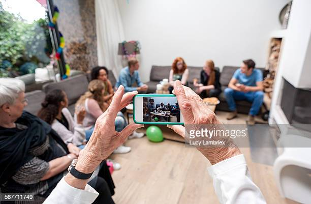 Woman photographing her family