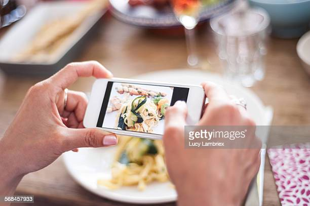Woman photographing her food