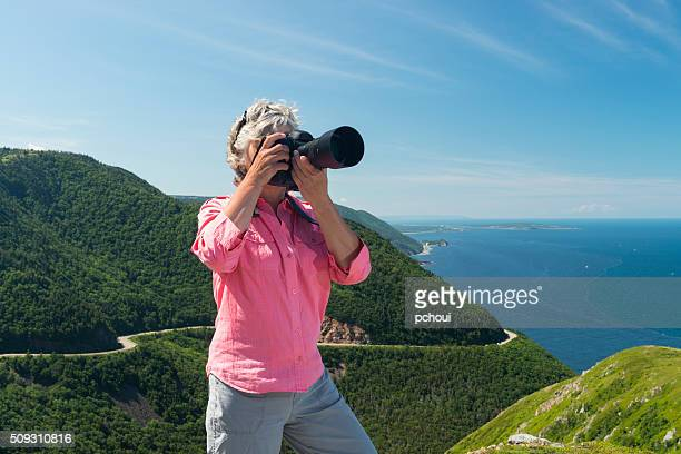 Woman photographing, Skyline, Cabot trail, Cape Breton, Nova Scotia