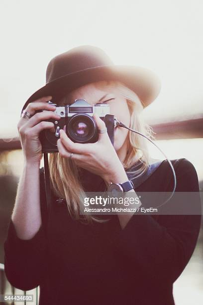 Woman Photographing Through Retro Camera