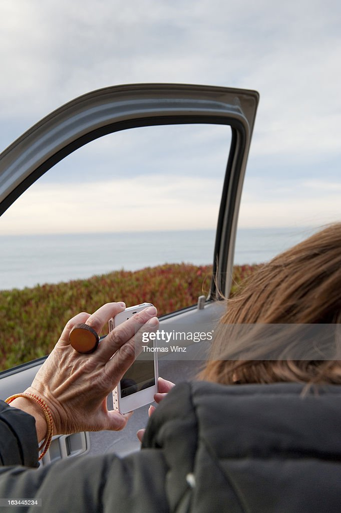 Woman photographing with a smart phone : Stock Photo