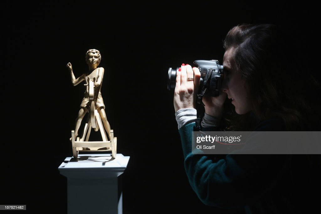 A woman photographs a maquette for the Fourth Plinth proposal by Elmgreen and Dragset entitled 'Powerless Structures, Fig. 101' which features in the exhibition 'Fourth Plinth: Contemporary Monument' at the ICA on December 4, 2012 in London, England. The exhibition at the Institute of Contemporary Arts features maquettes by artists including Tracy Emin, Antony Gormley, Anish Kapoor, it opens tomorrow and runs until January 20, 2013.
