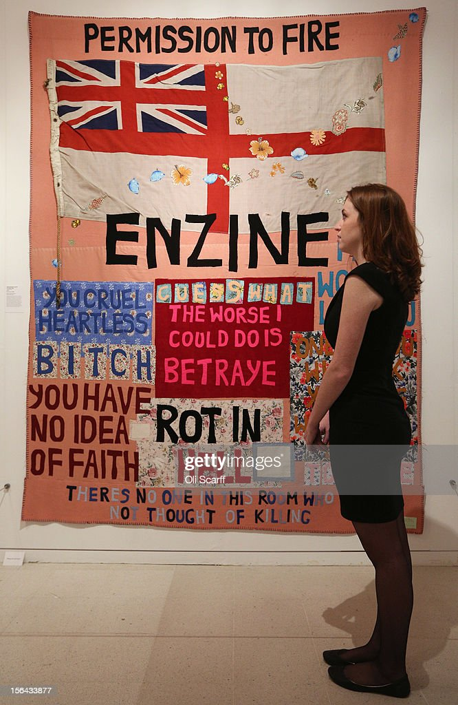 A woman photographs an artwork by Tracey Emin entitled 'Hate and Power Can Be a Terrible Thing' in the 'Perfect Place to Grow' exhibition at The Royal College of Art in celebration of their 175th anniversary on November 15, 2012 in London, England. The Royal College of Art's major exhibition, 'The Perfect Place to Grow', features over 350 works of art and design by RCA graduates and staff including: Henry Moore, Tracey Emin and David Hockney. The RCA is the world's oldest art and design university in continuous operation and it currently educates 1,200 postgraduate students from 55 different countries.