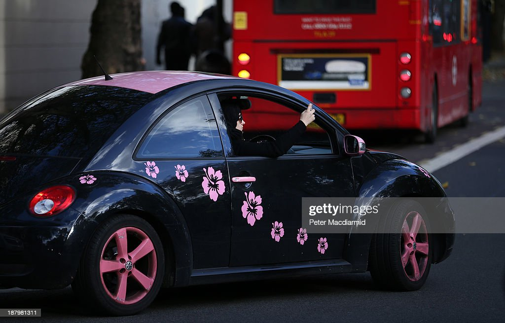 A woman photographs an Ashura day mourning procession from her car on November 14, 2013 in London, England. Ashura is a day of solemn mourning for the martyrdom of Hussein in 680 AD.