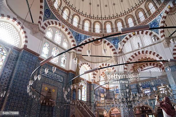 Woman photographs interior of Rustem Pasha