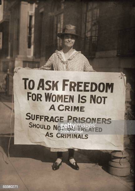 A woman pickets holding a sign reading 'To Ask Freedom For Women Is Not A Crime' 1917