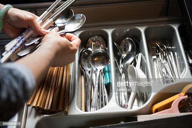 Woman picking chopsticks and spoons