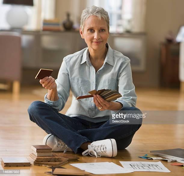 Woman picking floor paneling