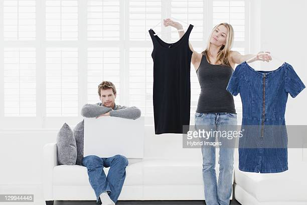 Woman picking out clothes in living room
