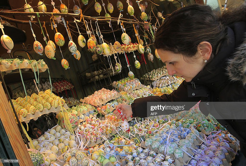 A woman picks a hand painted decorative Easter egg at the Schonbrunn Ostermarkt (Easter Market) at the Palace of Schoenbrunn in Vienna on March 27, 2013.