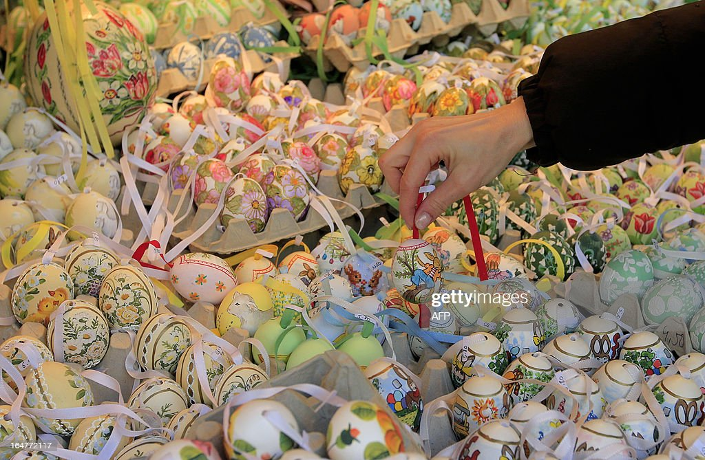 A woman picks a hand painted Easter egg at the Schonbrunn Ostermarkt (Easter Market) in Vienna on March 27, 2013.