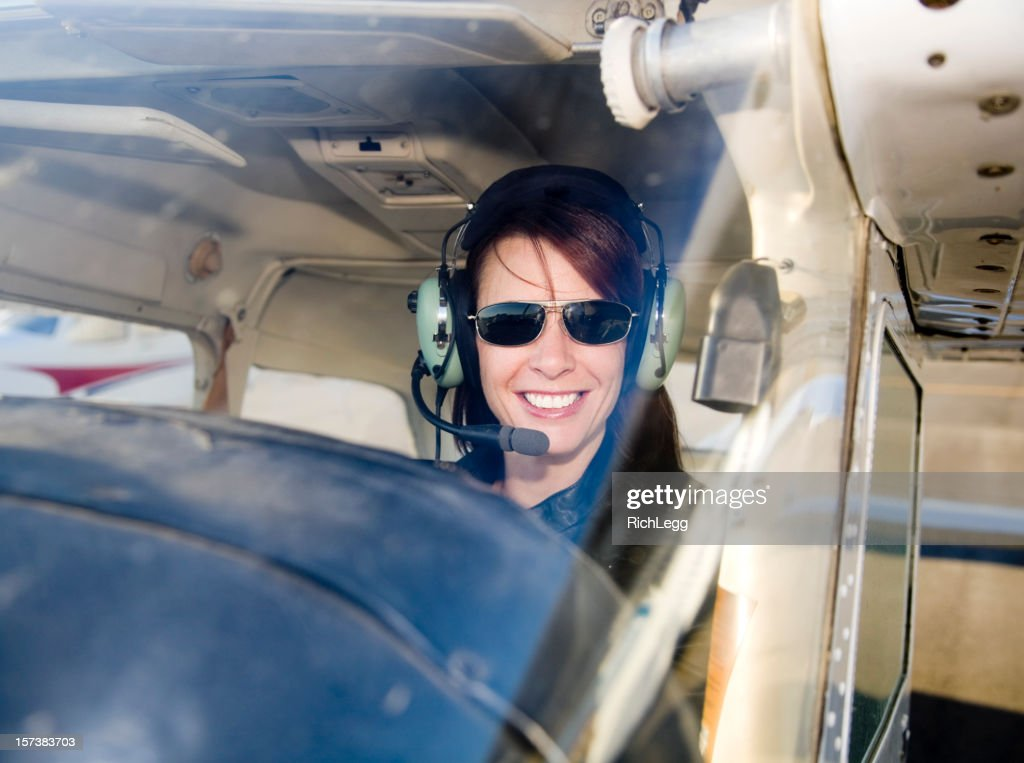 Woman Pilot in an Airplane