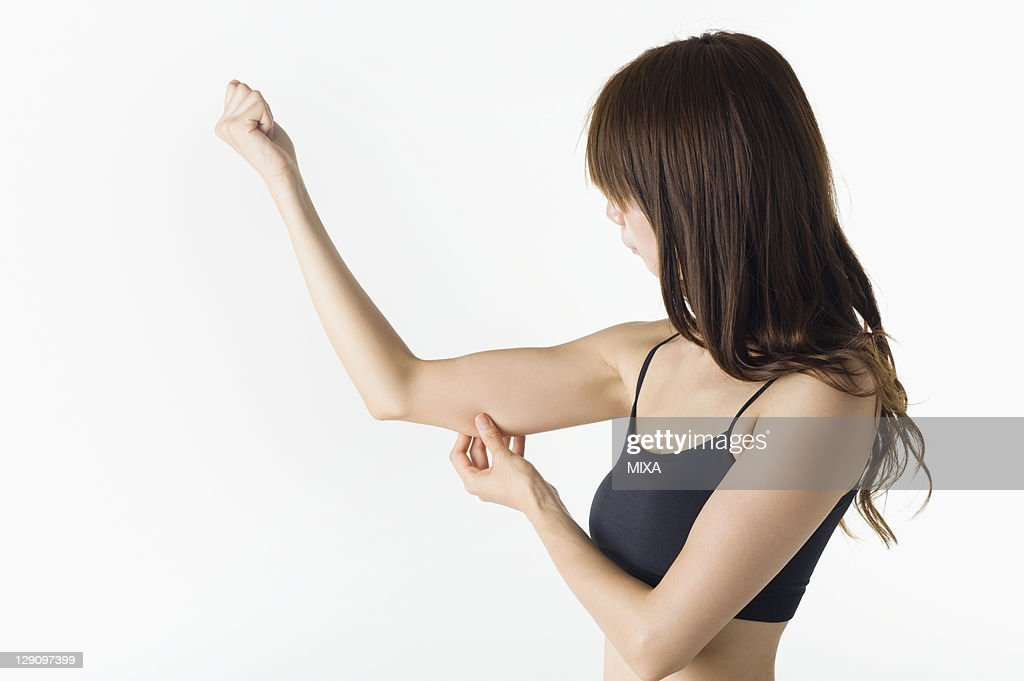Woman Pinching Arm