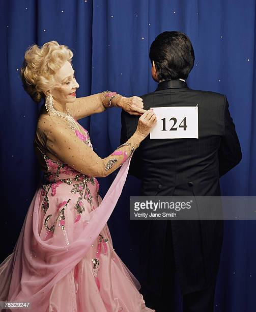 Woman pinning number on partner for competition