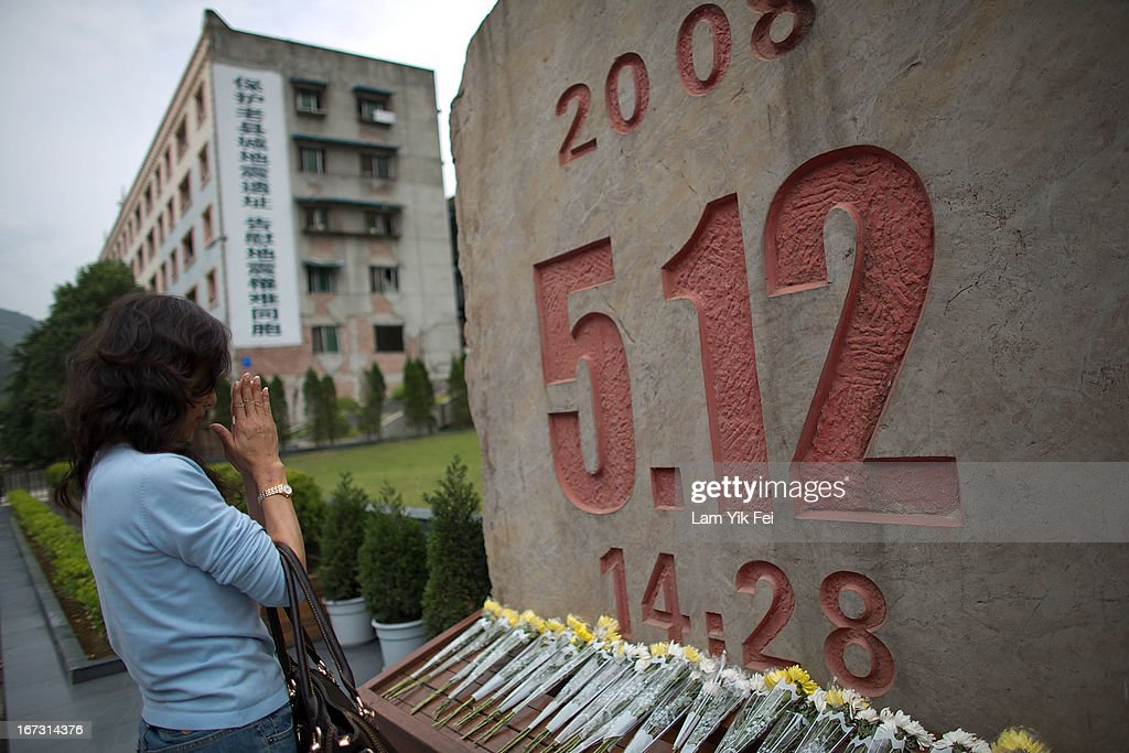 A woman places flowers and mourns for the victims who died in the earthquake at a memorial park at the Beichuan town in Sichuan province on April 24, 2013 in Chengdu, China. The Beichuan earthquake memorial was built in memory of the over 70,000 that perished in the deadly 2008 quake that struck Sichuan province and was built near the Beichuan Middle School, where over 1,000 students and teachers died. With the five year quake anniversary only a few weeks away, residents of Sichuan province are coming to grips with the April 20 earthquake in nearby Ya'An that claimed the lives of over 190 people and injured thousands.