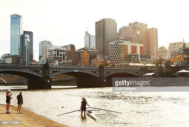 A woman places her boat in the water before rowing on the Yarra River on August 18 2016 in Melbourne Australia Melbourne has been named as the...