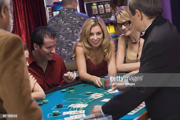 Woman placing large bet at blackjack table