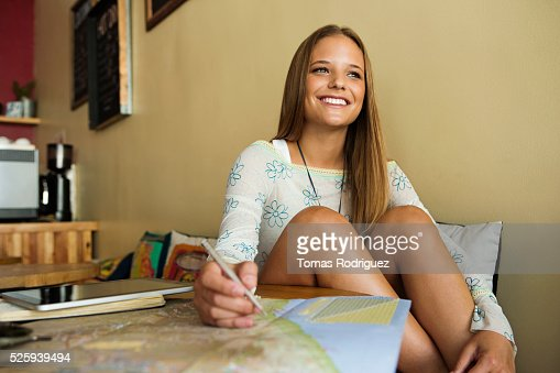 Woman planning trip with world map : Stock Photo