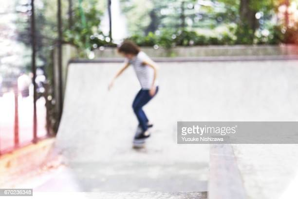 A woman playing a skateboard