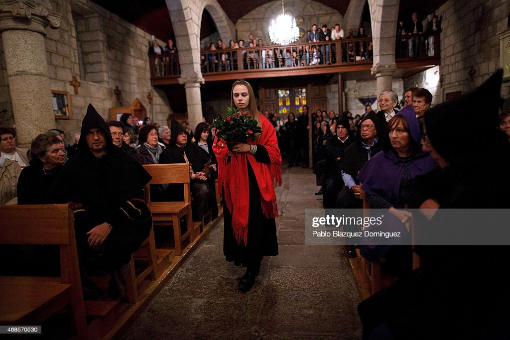 A woman playing as <a gi-track='captionPersonalityLinkClicked' href=/galleries/search?phrase=Mary+Magdalene&family=editorial&specificpeople=230525 ng-click='$event.stopPropagation()'>Mary Magdalene</a> takes part in a ceremony on April 3, 2015 in Monsanto, in Idanha A Nova region, near Castelo Branco, Portugal. Dressed in traditional costumes local people take part in rituals, processions and chants recreating events related to Jesus Christ's life. Easter week is widely celebrated across the Iberia Peninsula.