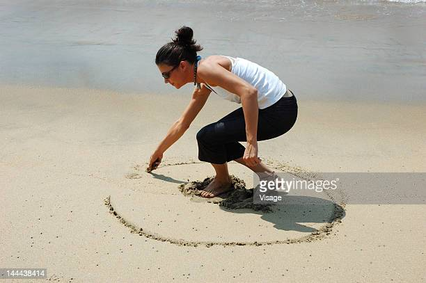 A woman playing at the beach