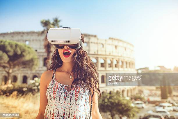 Woman playing augmented reality with VR headset