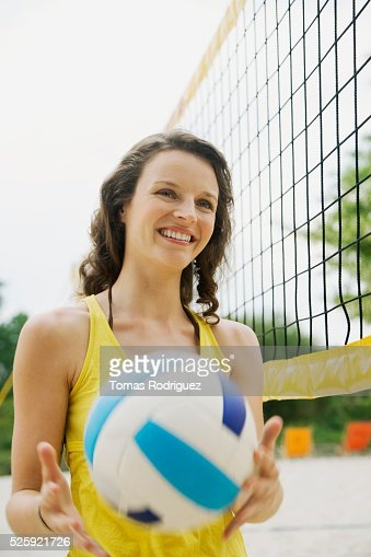 Woman Playing Beach Volleyball : Stock Photo