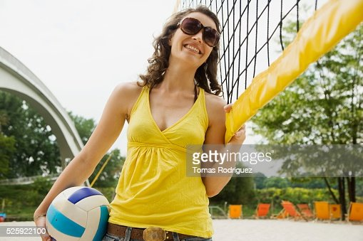 Woman Playing Beach Volleyball : Stockfoto