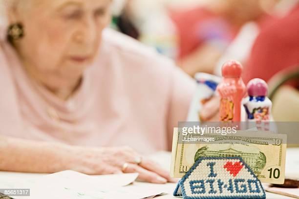 Woman playing bingo with money