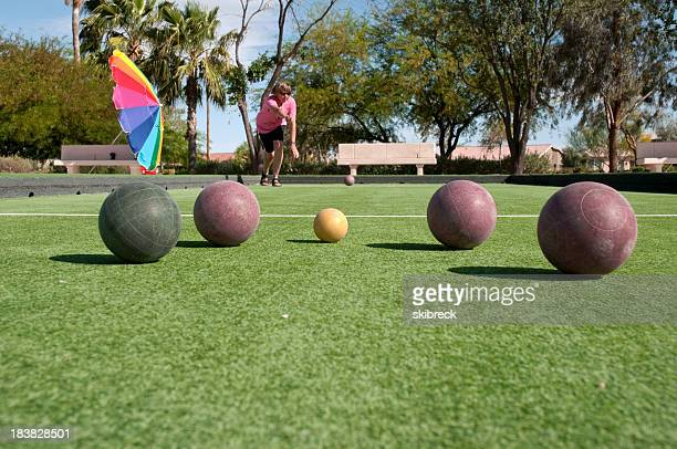 Woman Playing Bocce