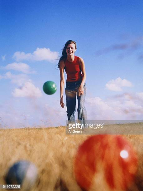 Woman playing boccia on a field