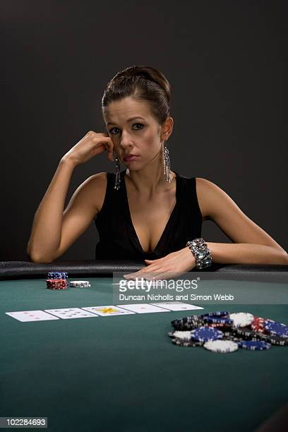 Woman playing cards in casino