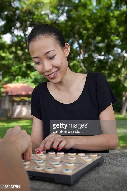 Woman playing chinese chess