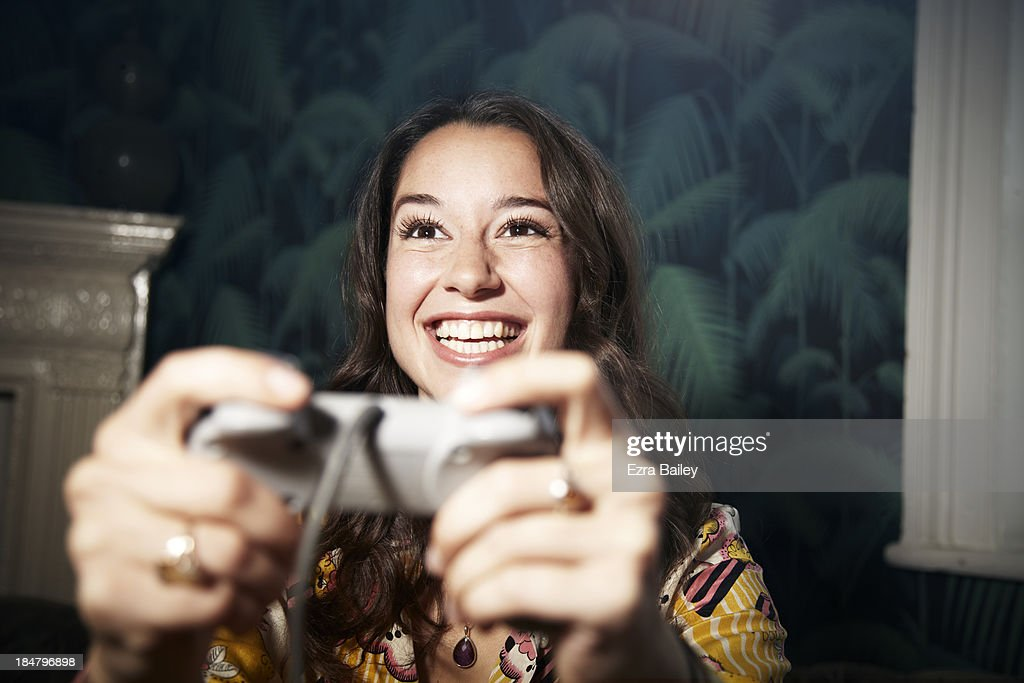 Woman playing computer games. : Stock Photo