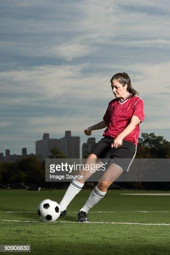 Woman playing football : Stock Photo