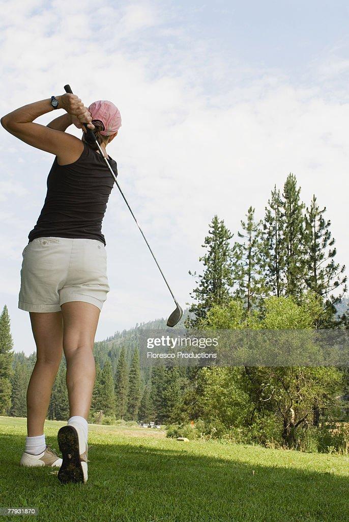 Woman playing golf : Stock Photo
