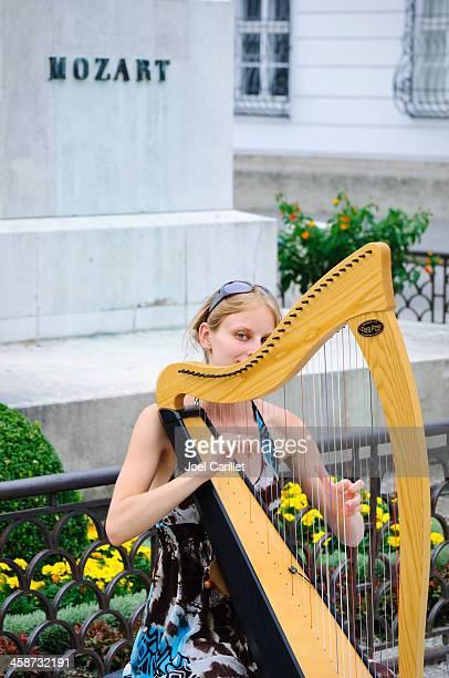 Woman playing harp in Salzburg, Austria