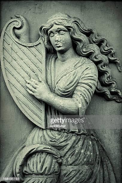 Woman playing harp
