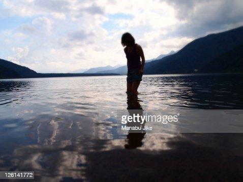 Woman playing in Lake Saiko