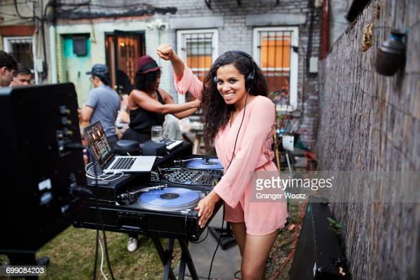 Woman playing music at party in backyard