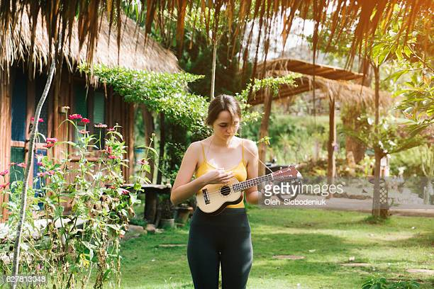 Woman playing on ukulele