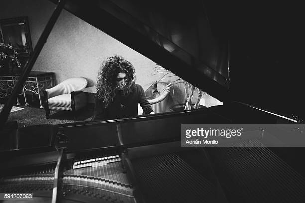 Woman playing piano in black and white