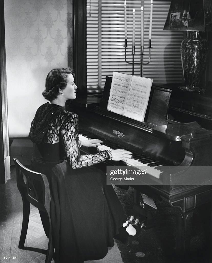 Woman playing piano, (B&W) : Stock Photo