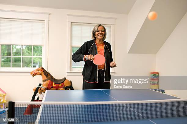woman playing ping pong