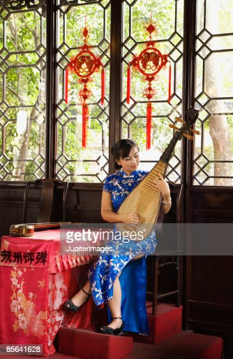 Woman playing pipa or Chinese lute